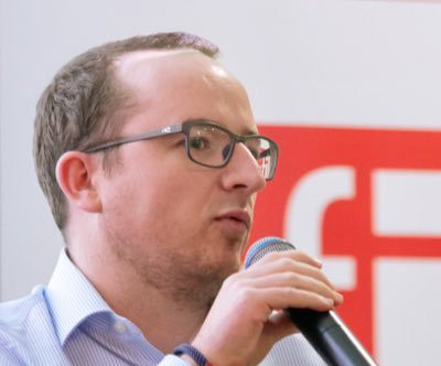 Maxime Bayen speaking at an event