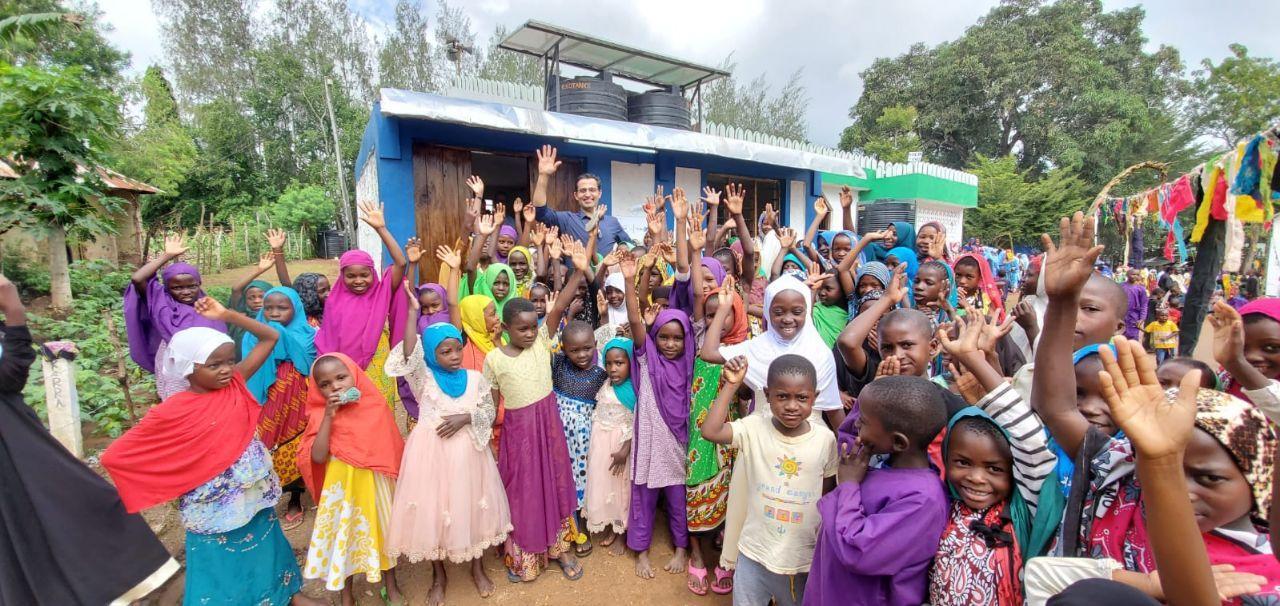 Boreal's Hamed Beheshti poses with the residents of Burani, Kwale County, Kenya