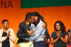 Two contestants hug during the AGRF