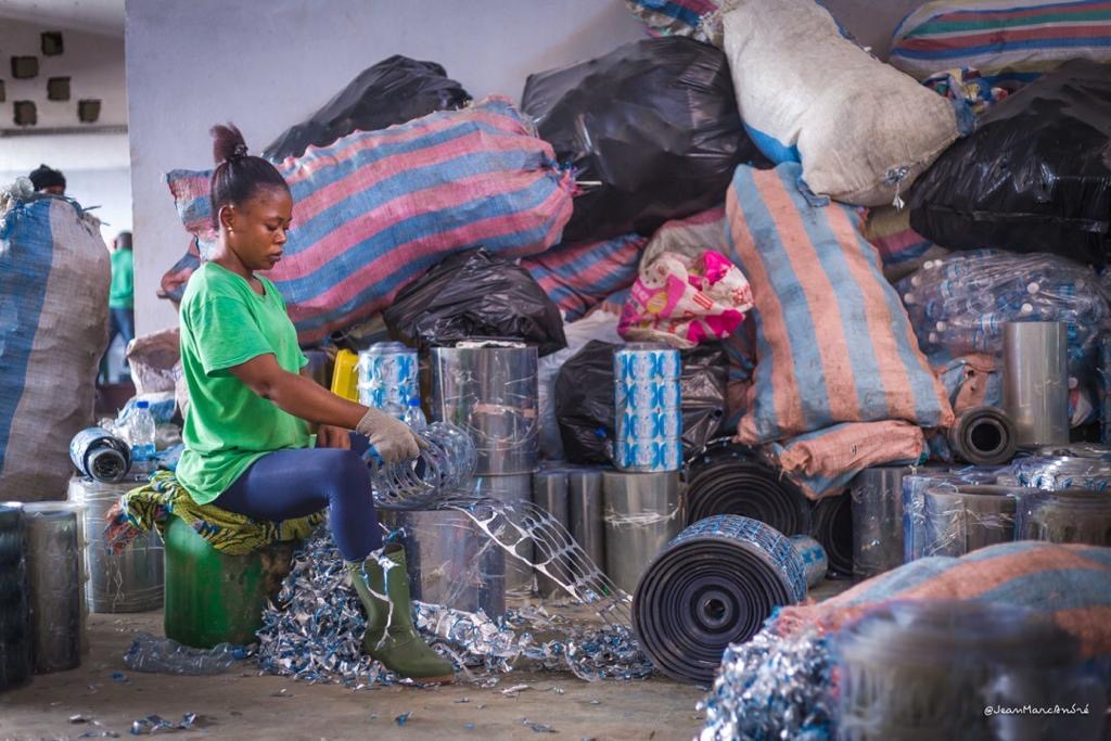 A woman sorting plastic